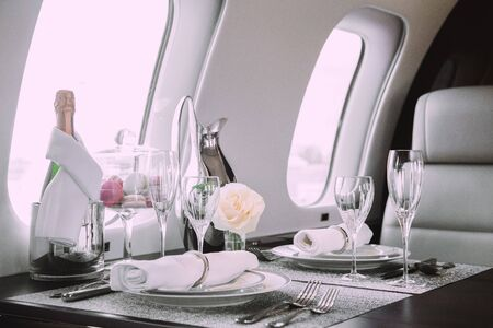 Modern and comfortable interior of business jet aircraft with decor 版權商用圖片 - 130742945