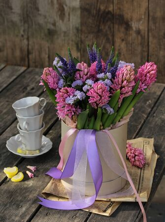 hyacinths in a beautiful box on a wooden table Reklamní fotografie