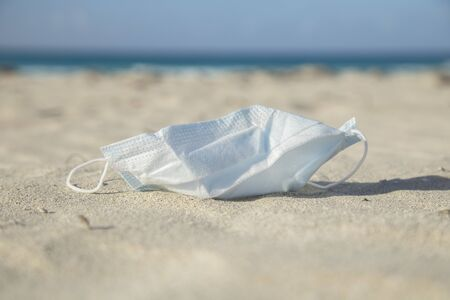Medical protective mask for coronavirus protection on the  beach in a tropical country at summer day Reklamní fotografie