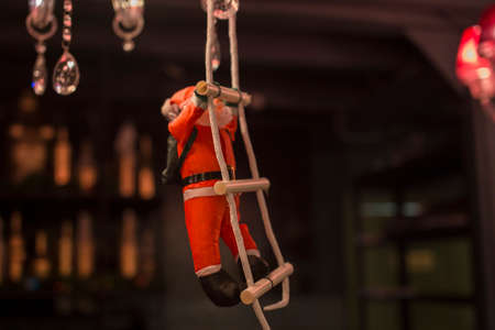 Christmas Santa Claus toy on the chandelier in the bar