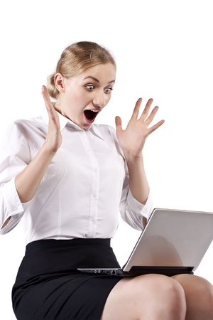 Surprised girl with laptop over white Stock Photo - 12402164