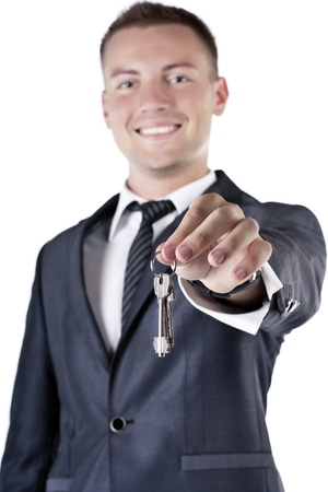 Business man giving you the keys to a home photo