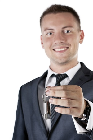 Business man giving you the keys to a home Stock Photo - 12621352
