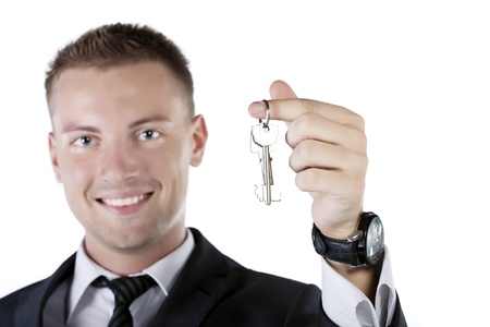 Young businessman holding a key photo