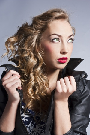 Beautiful slim sexy blond, girl in leather jacket Stock Photo - 12621653