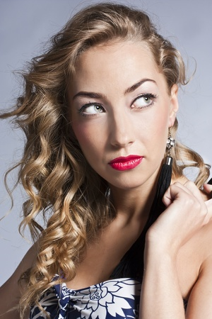 Glamour portrait of beautiful,curly blonde photo