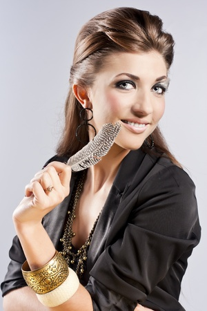 Young brunette lady with luxury accessories photo