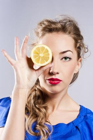 Beautiful blond with lemon photo