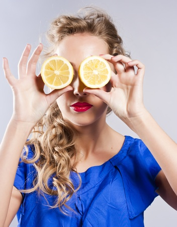 Beautiful blond with lemon photo