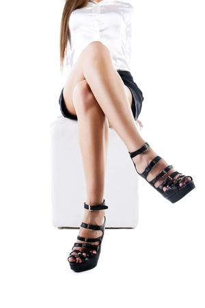 Beautiful female legs with black high heels, isolated on white b