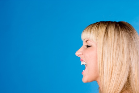 Profile portrait of young blonde caucasian woman who s mouth is photo