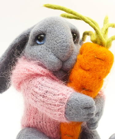Beautiful toy rabbit with orange carrot