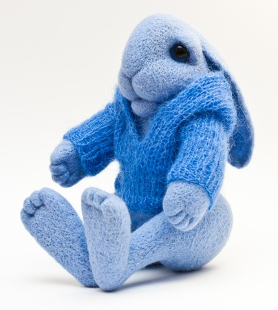 Lovely rabbit toy knitted sweater Stock Photo - 12622412