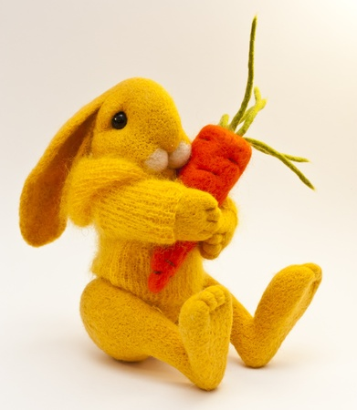 Beautiful toy rabbit with orange carrot Stock Photo - 12622411