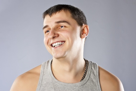 Young man in grey t-shirt studio shot Stock Photo - 12903532