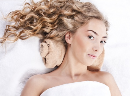Beautiful young woman with long curly hair Stock Photo - 12904320