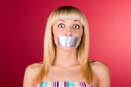 Blonde with duct tape on her lips photo