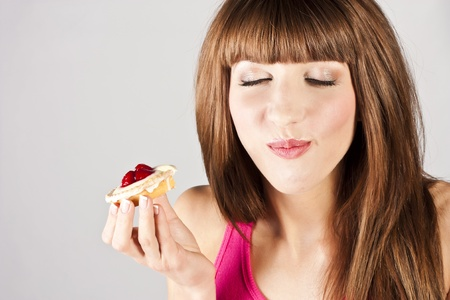 Young beautiful woman with a cake Standard-Bild