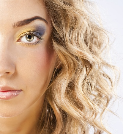 Curly blonde with bright makeup Stock Photo