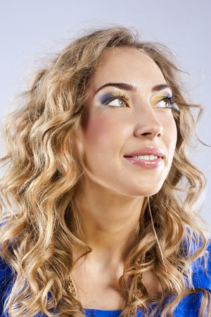 Curly blonde with bright makeup photo