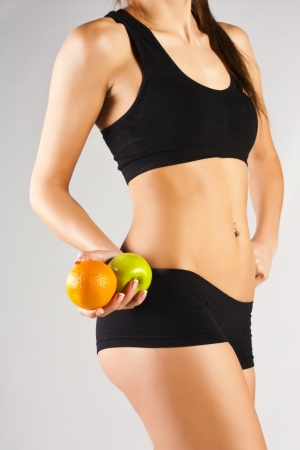Concept of a healthy body  Thin belly, fruit photo