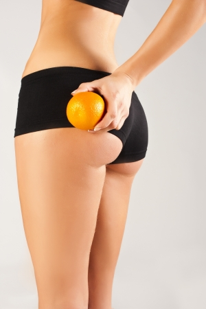 Concept of a healthy body  Beautiful bottom, fruit