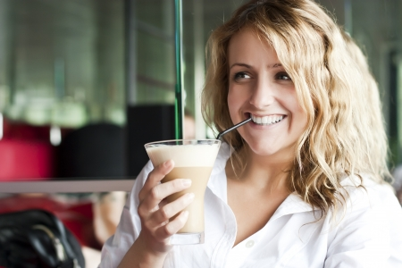 Beautiful woman in street cafe ,with cup Standard-Bild
