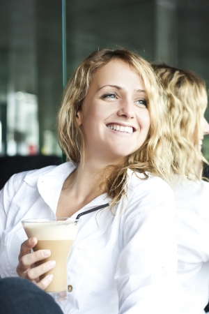 Beautiful woman in street cafe ,with cup photo