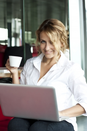 Young pretty woman with laptop, indoors photo