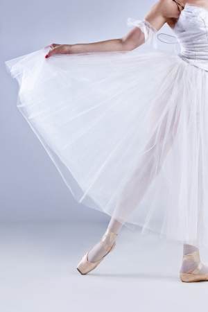 Beautiful ballerina posing, on gray studio background  photo