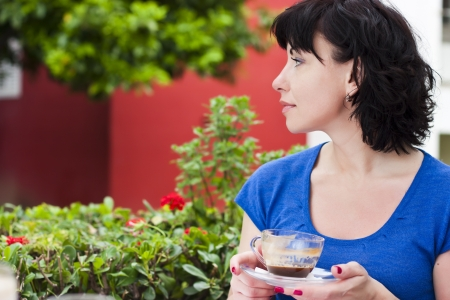 Happy woman drinking coffee Standard-Bild