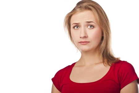 Young frustrated woman in studio