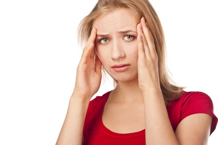afflict: Young woman have a headache