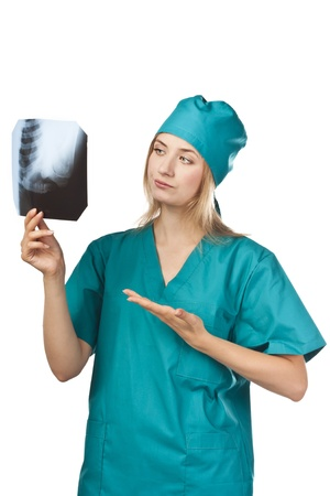 Young nurse in a studio with an X-ray photo