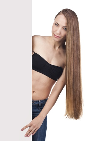 girl with long hair holding a poster Stock Photo