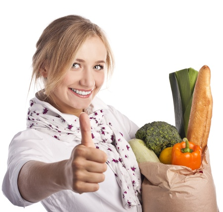 Smiling young woman holding a shopping bag Standard-Bild