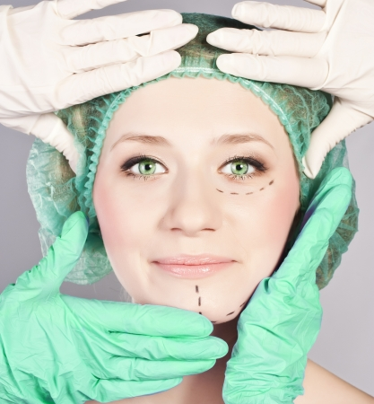 Plastic surgery, touching the head of beautiful, female face
