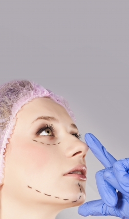 correction lines: Doctor draw correction lines on woman face  Before plastic surgery operetion