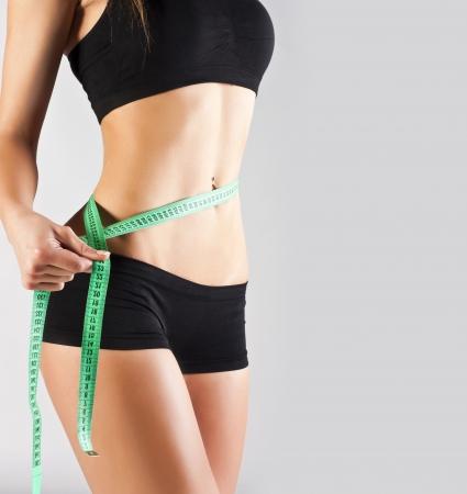 cintura perfecta: Cuerpo perfecto de una mujer joven en el estudio Foto de archivo