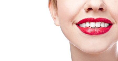 Close-up happy female smile with healthy white teeth, Cosmetology, dentistry and beauty care. Macro of woman's smiling mouth Stock Photo - 18902744