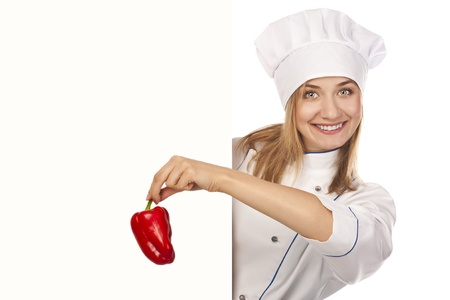 Happy woman cook or baker holding over paper sign billboard. photo