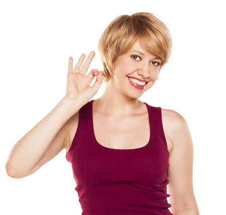 attractive woman in a red T-shirt. studio Stock Photo - 21054465