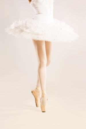 legs of ballerina standing in pointes in studio Stock Photo