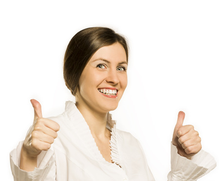 Friendly cheerful smiling business woman showing ok gesture isolated on white