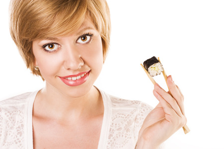 attractive girl with sushi and roll Standard-Bild