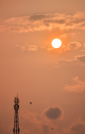 modulation: Telecommunication tower with sunset and cloud Stock Photo