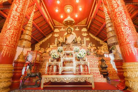 in wat phra kaew: CHIANG RAI, THAILAND - NOVEMBER 09, 2015: Buddha image in church of Wat Phra Kaew Temple interior. Editorial