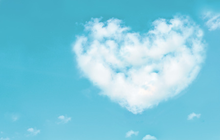 heaven light: Beautiful clouds in heart shape on blue sky. Love nature concept. Vintage style.