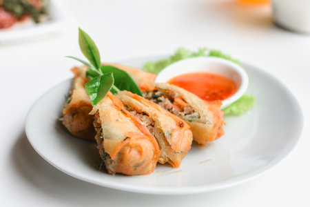 Closeup fried spring rolls served with sweet sauce. Stock Photo