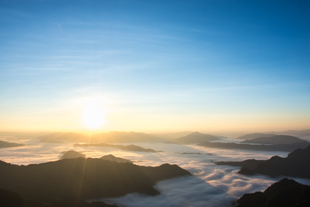 A panorama view of mountain with sun in morning at Phu chi fa, Chiang Rai, Thailand.